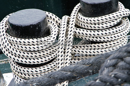 2 ship bollards with lashed ropes