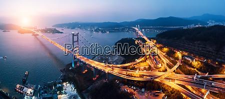 tsing ma bridge at sunset in