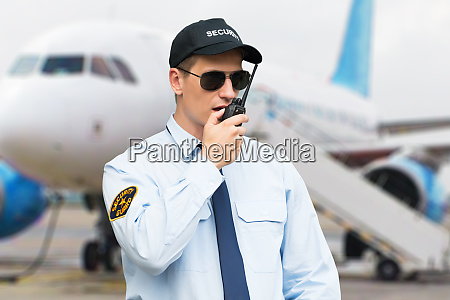 portrait of a security guard talking