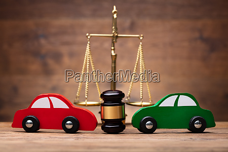 two red and green car in