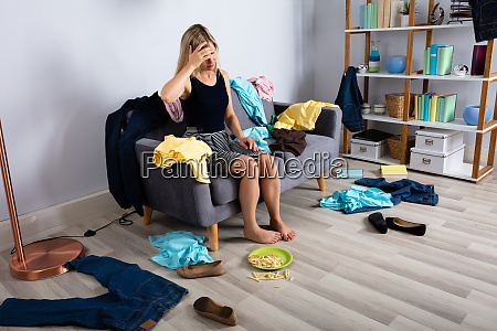 upset woman sitting on sofa in