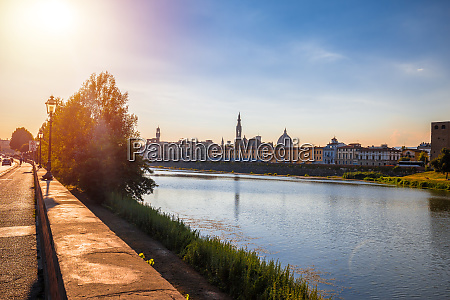 arno river waterfront of florence sunset