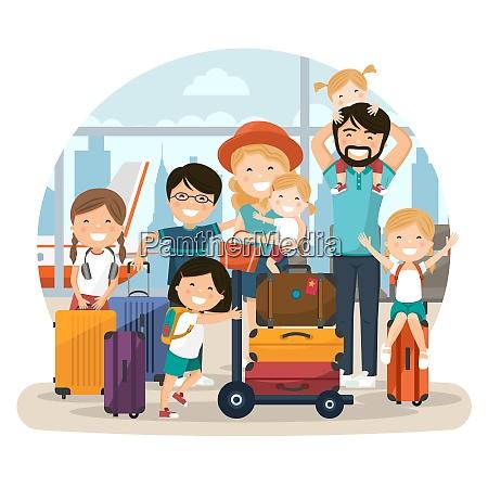 glueckliche zahlreiche familie am flughafen wartet