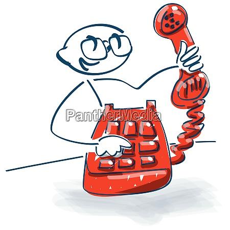 steckfigur mit altem telefon mit handy