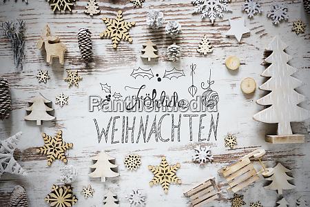flat lay calligraphy froehliche weihnachten means