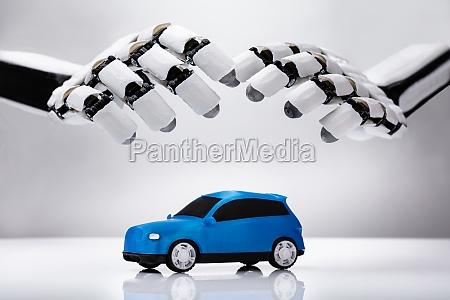 robot protecting blue car