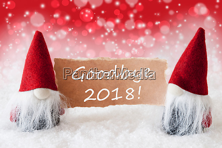 rote christmassy gnome mit karte text