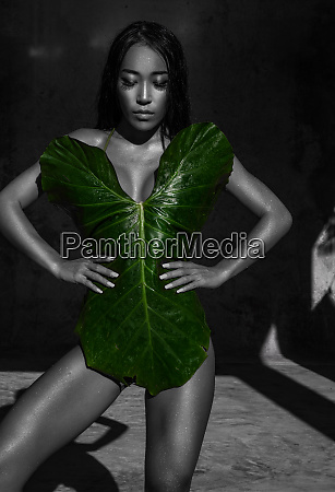 sensual beauty covered with jungle leaf
