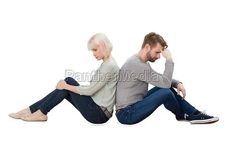 upset couple sitting back to back