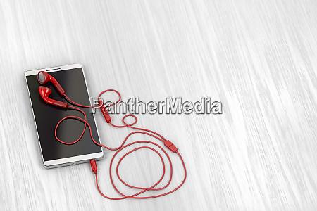 smartphone und rote ohrhoerer
