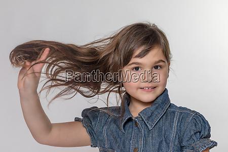 studio portrait of long haired little