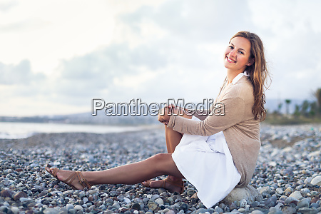 young woman on the beach enjoying