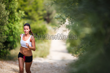 beautiful young female runner on a