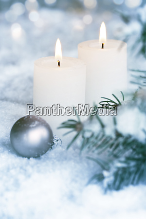 candlelight in frosty snowy winter