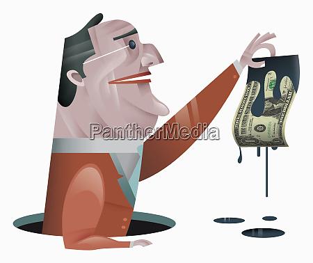 geschaeftsmann haelt dollar rechnung tropft OEl