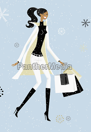 snow falling around chic woman with