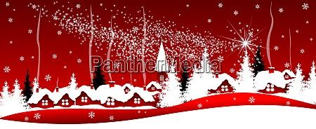 glaenzender weihnachtsstern ueber dem dorf