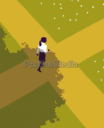woman walking into crossroads