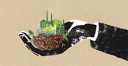 man holding green factories in cupped
