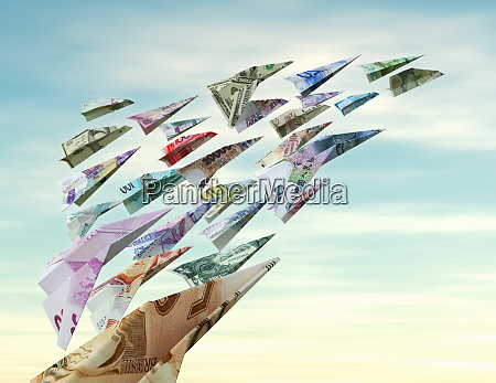 international currency flying as money paper