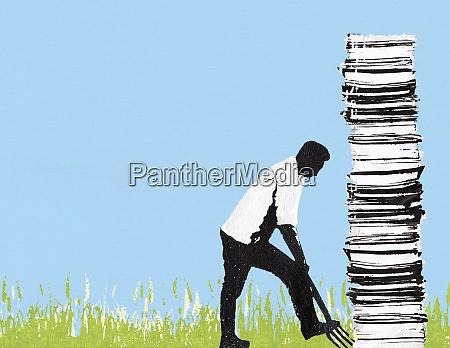 mann graebt hohen papierstapel