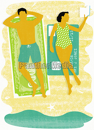 man and woman sunbathing on banknote