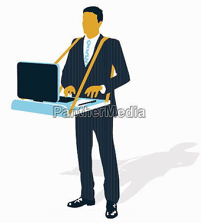 businessman standing working on computer on