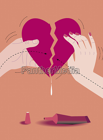 man and woman gluing torn heart
