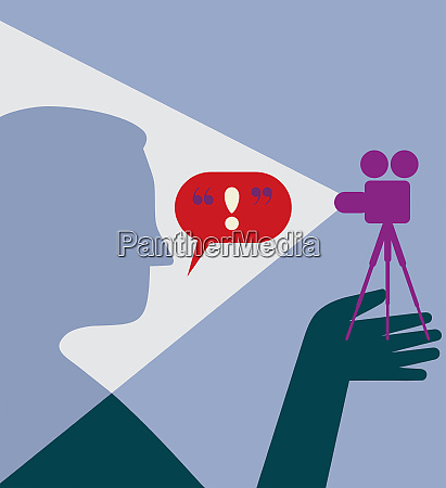 man being filmed talking to movie
