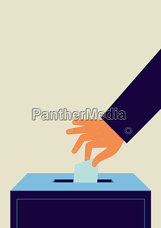 hand putting ballot into ballot box