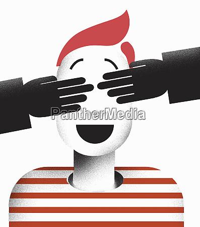 people covering boys eyes