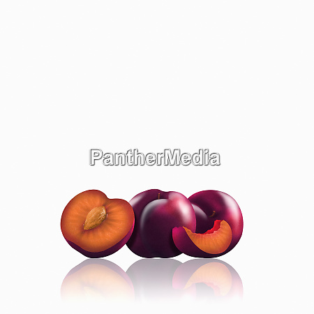 whole and cut red plums