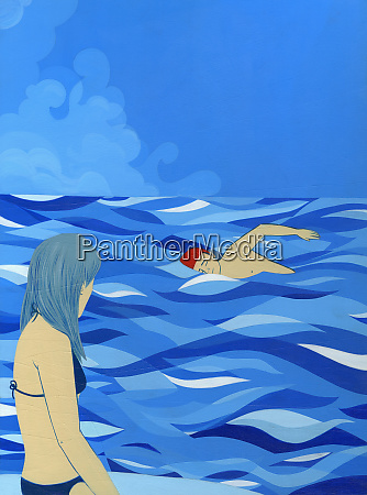 woman watching man swim in ocean