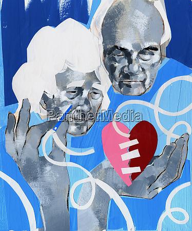 senior couple sewing broken heart