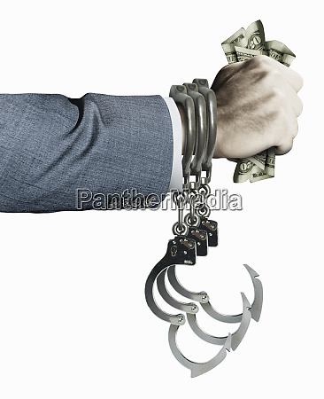 businessman in handcuffs with fistful of