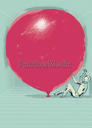 geschaeftsmann ueber grossen roten ballon pop