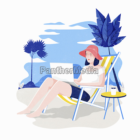 woman using laptop on holiday sitting