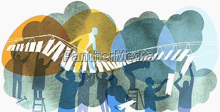 man walking on bridge supported by