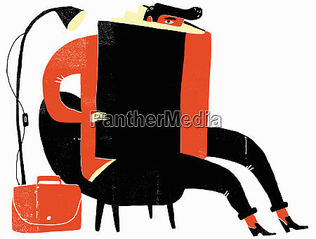 man hiding in large book