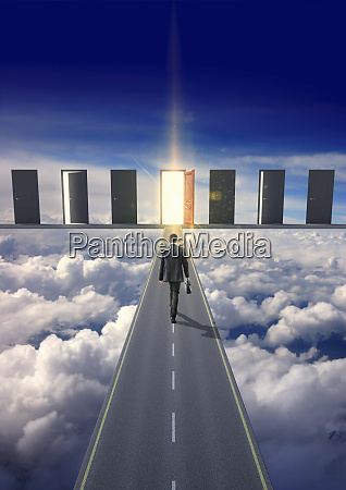 businessman on road in clouds walking