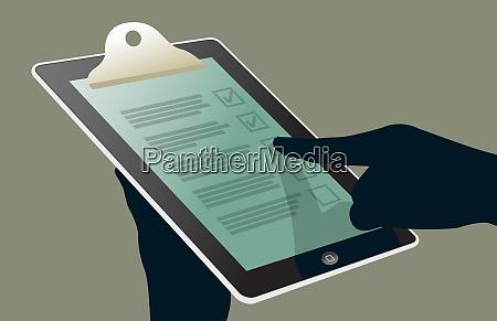 close up of hand using checklist