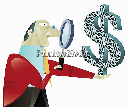 businessman examining dollar symbol with magnifying