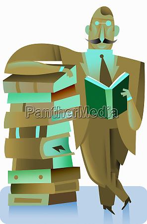 businessman enjoying reading book leaning against