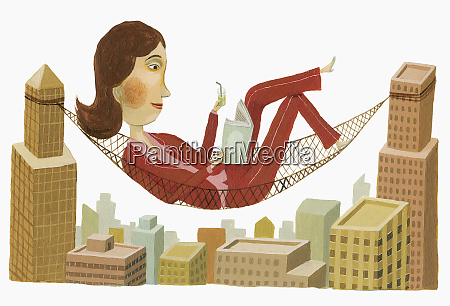 businesswoman reading in hammock between highrise