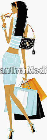 chic woman carrying shopping bags