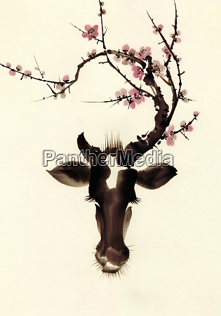 blossom branches growing from cows head