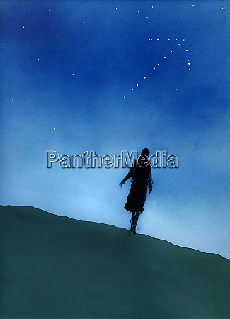 silhouette of woman walking on hill