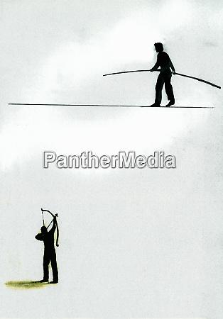 man aiming bow and arrow at