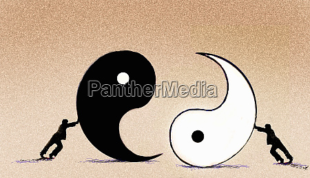 businessmen pushing yin and yang symbols