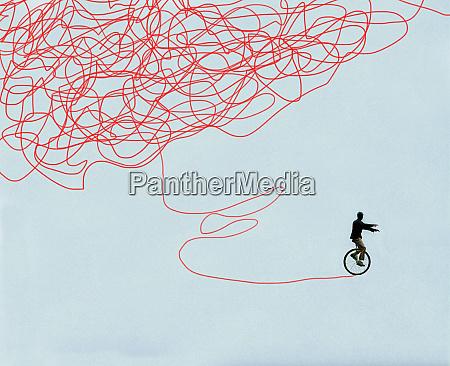 mann verbessert balance auf einrad erfolgreich